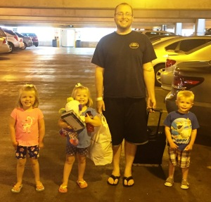 The kids help walk daddy to the van. Note all the things Natalie is carrying.